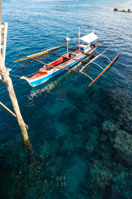 Elevated view of a traditional double outrigger canoe called a paraw in the Philippines