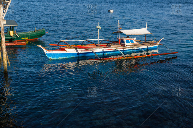 Traditional paraw boat in the water, Philippines