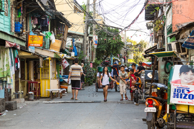 Manila, Philippines - December 23, 2015: Street scene with people in Manila, Philippines