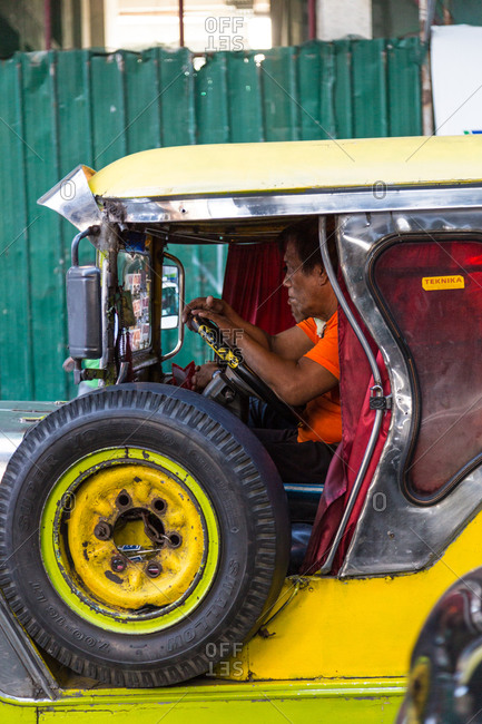 Manila, Philippines - December 23, 2015: Man driving a taxi in the Philippines