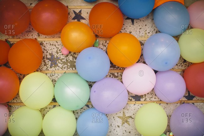 Multi-colored balloons attached to a board for a carnival game