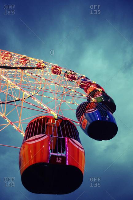Ferris wheel buckets on a carnival ride at dusk