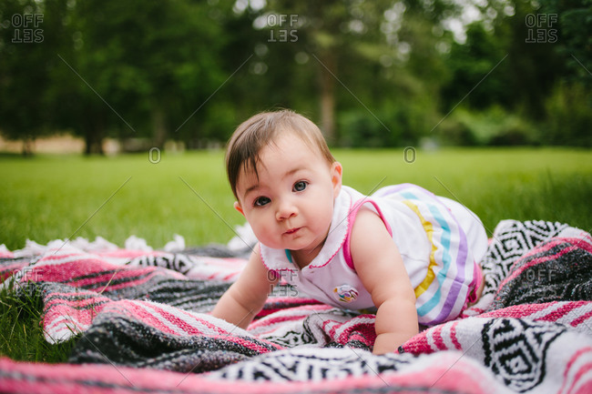 Baby on a blanket in field