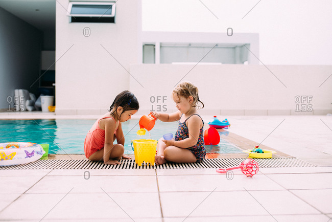 Girls playing with pool toys