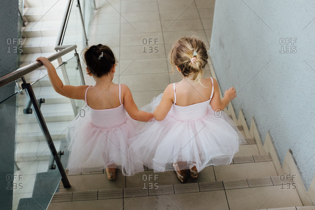 Girls in tutus on stairs