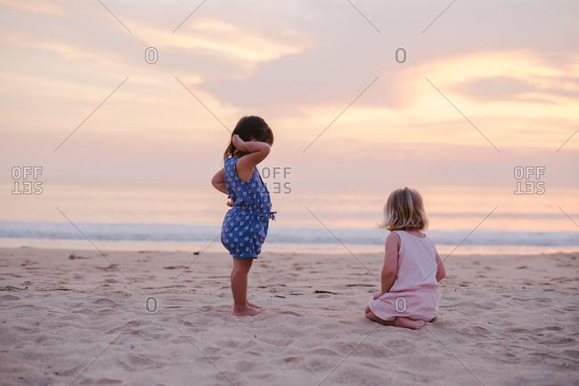 Two girls on evening beach