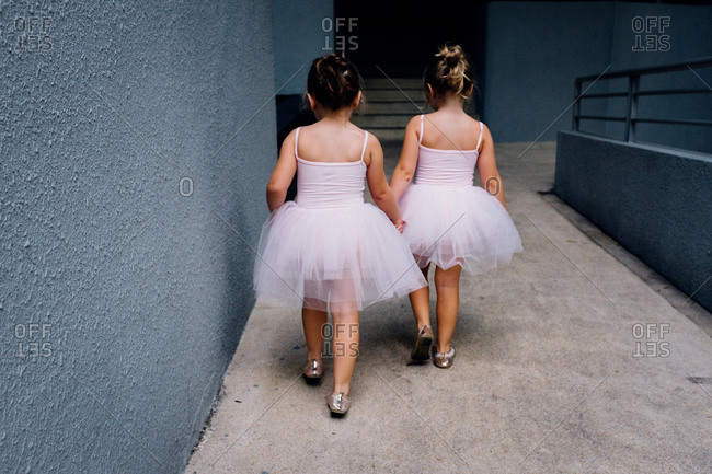 Girls in tutus in stairwell
