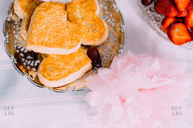 Heart shaped shortcakes and strawberries