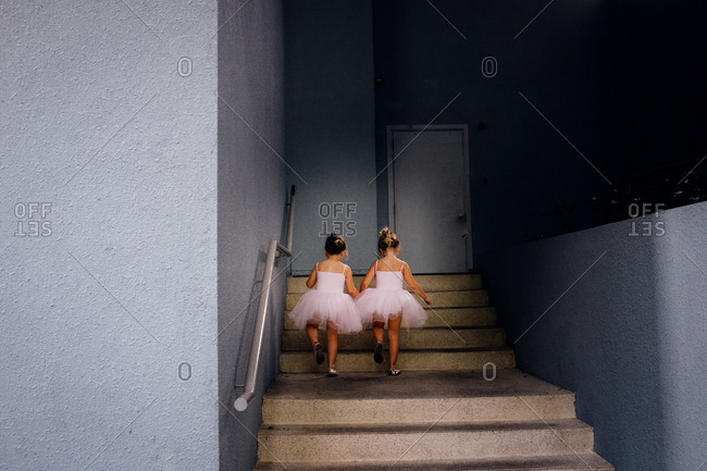Girls on stairs in tutus