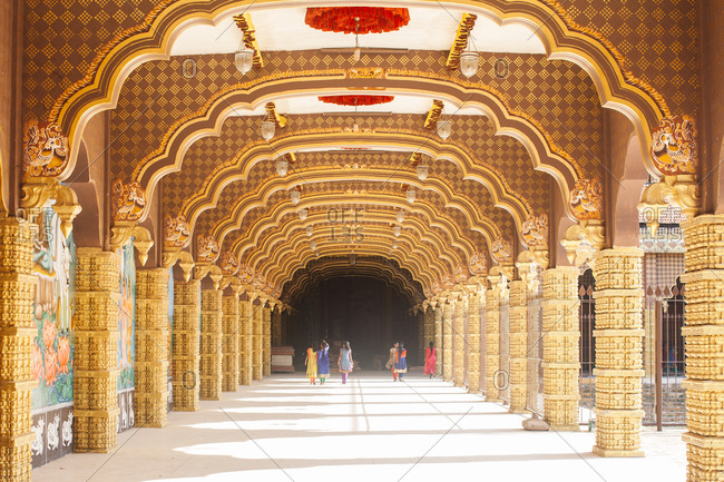 People in ornate archway, Sri Lanka