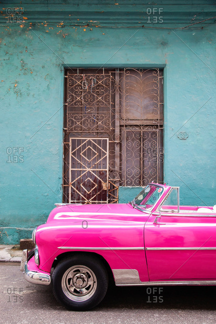 March 18, 2016 - Cuba: Vintage pink convertible parked on the street
