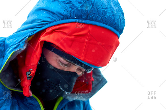 Portrait of a hiker covered in frosty snow