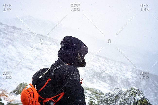 Mountaineer standing on a snowy mountainside in New Hampshire