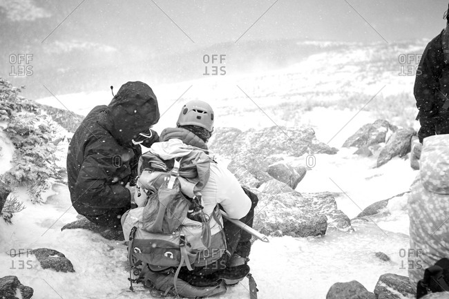 Mountaineers sitting on a snowy mountainside