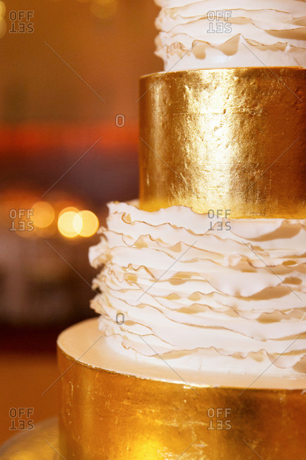 Close up of a gold wedding cake