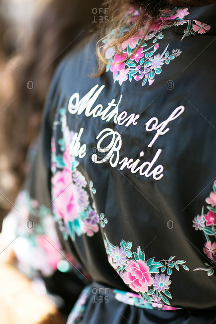 Close up of mother of the bride embroidered robe