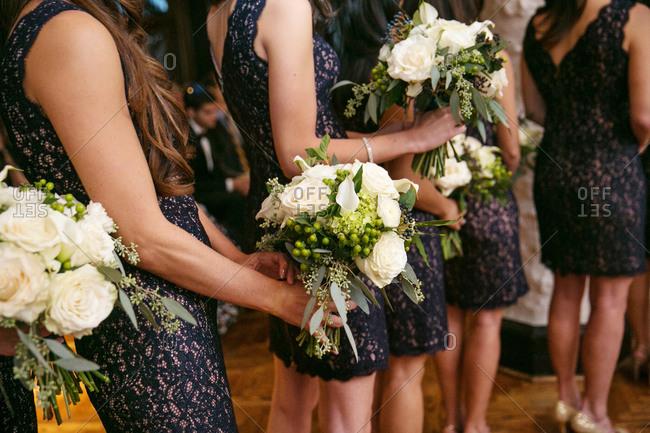 Bridesmaids holding bouquet