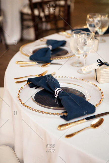 Table setting with navy blue napkins at a wedding