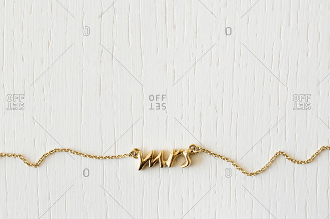 Necklace with the word 'Mrs' carved into the gold