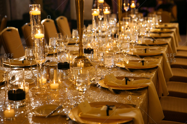 Long table set with candles, flowers, and table runner