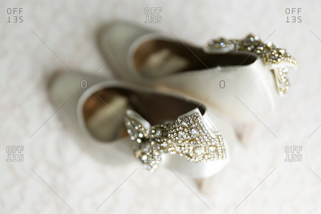 High-heeled shoes with jeweled bows