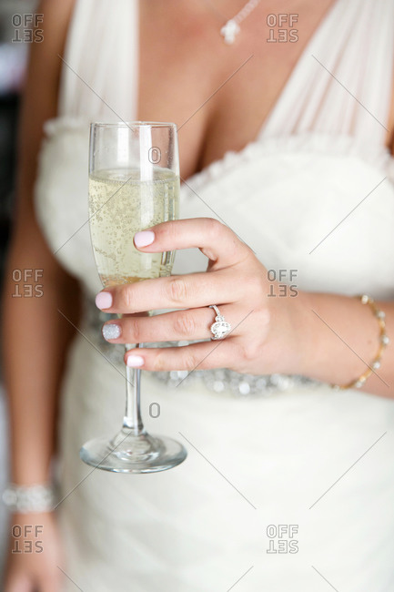 Close-up of a bride holding a glass of champagne