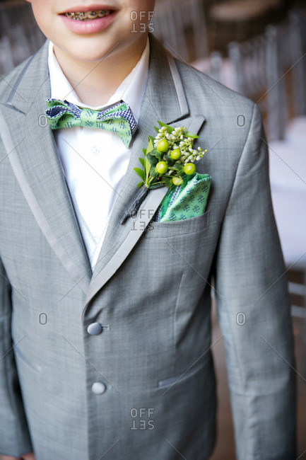 Close-up of a ring bearer\'s boutonniere and pocket square