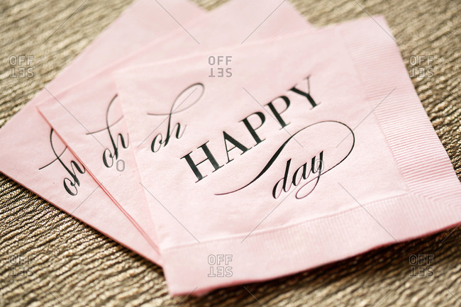 Pink cocktail napkin imprinted with the message 'Oh Happy Day'