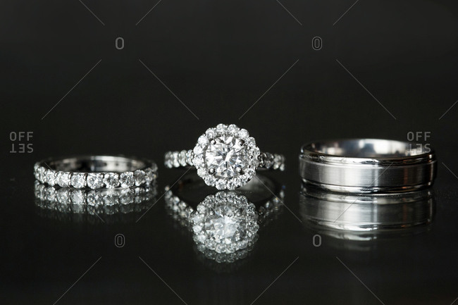 Close-up of a diamond ring and wedding ring