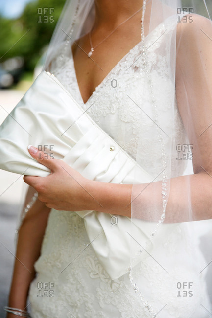 Bride holding a satin clutch purse