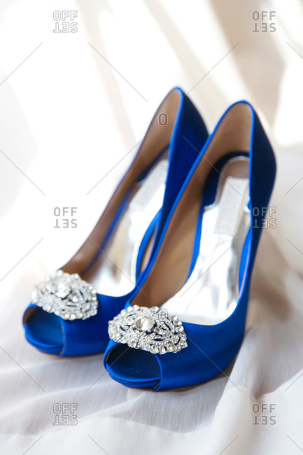 Open toe blue satin shoes with silver and diamond jewel