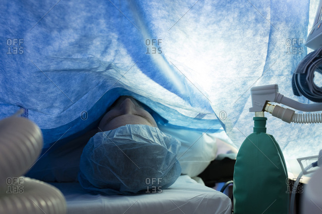 Patient prepared for surgery draped with a sheet