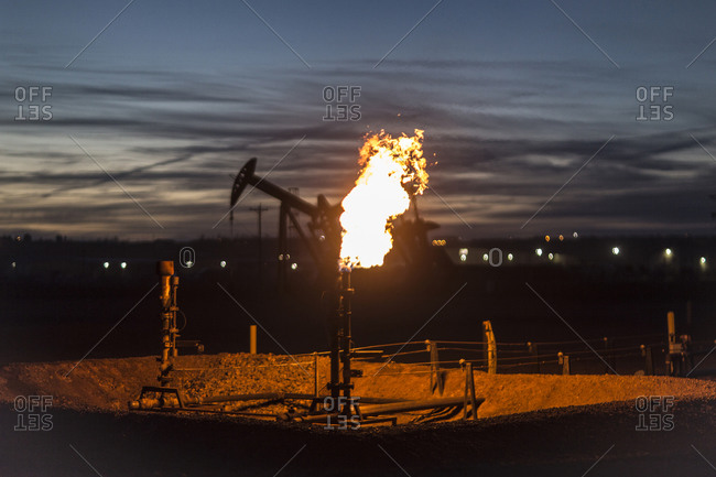 Gas flare burning at an oil drilling site