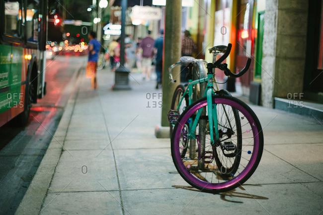 A bike on a city sidewalk