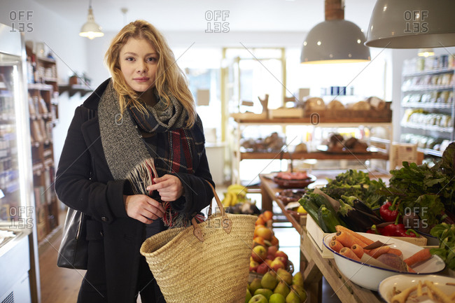 Portrait Of Woman Shopping For Produce In Delicatessen