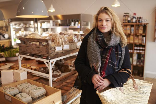 Portrait Of Woman Shopping For Organic Bread In Delicatessen