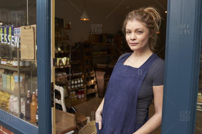 Portrait Of Female Delicatessen Owner Standing In Shop Door