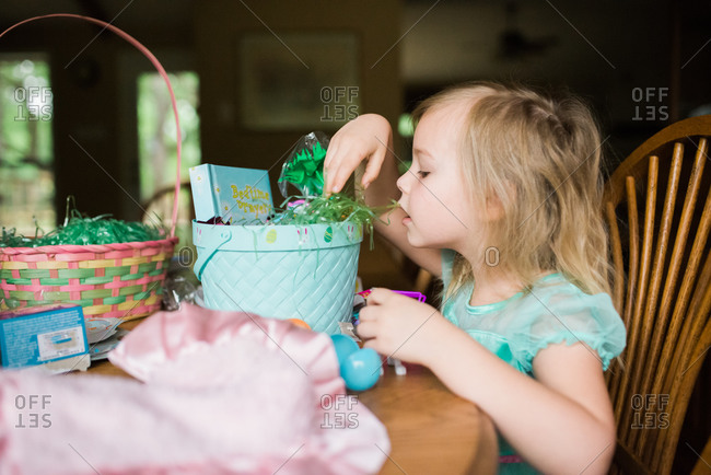 Girl looking at her Easter basket