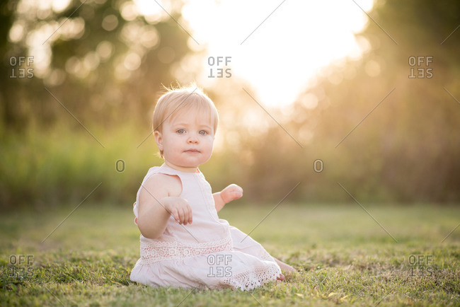Blonde girl on summer lawn