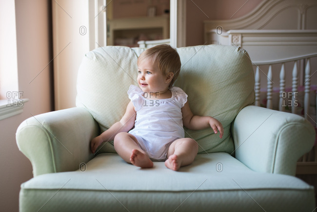 Blonde toddler in armchair