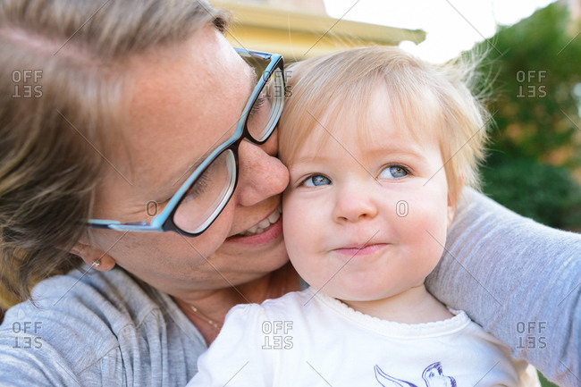 Affectionate woman with toddler girl