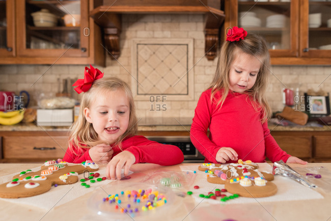 Girls decorating gingerbread cookies