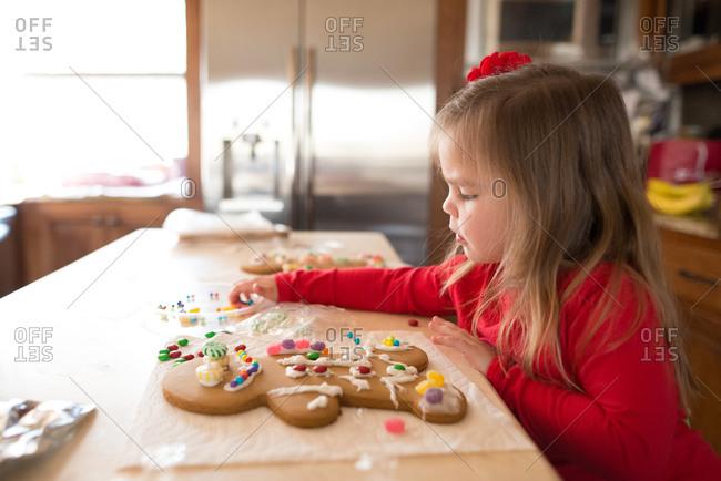 Girl working on gingerbread man