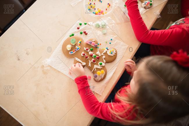 Girls decorating gingerbread man