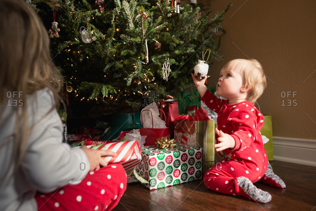 Girls by a Christmas tree