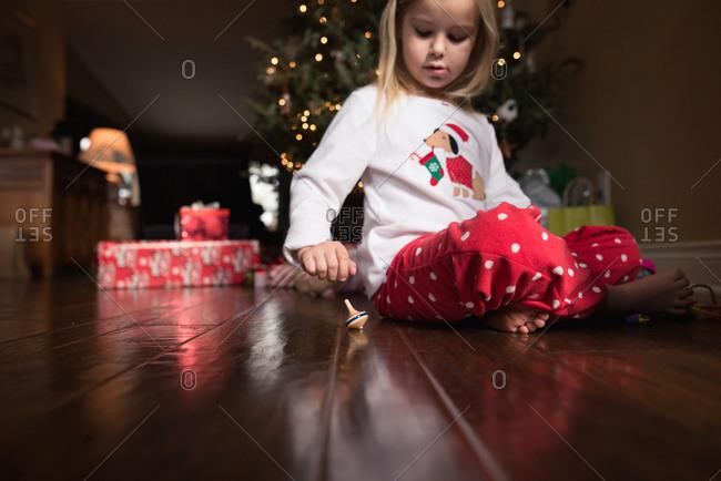 Girl spinning top at Christmas