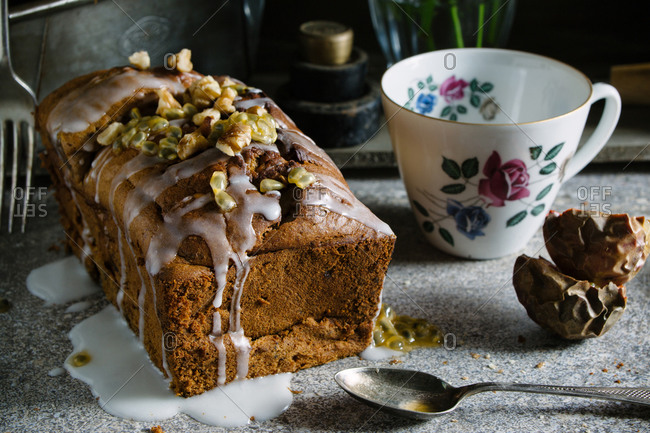 Banana walnut and passion fruit bread with a floral teacup
