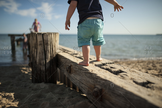 Child walking on beach structure