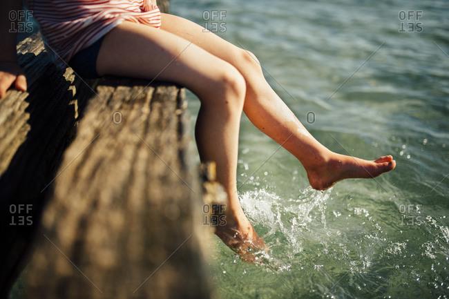 Child sitting on beach structure