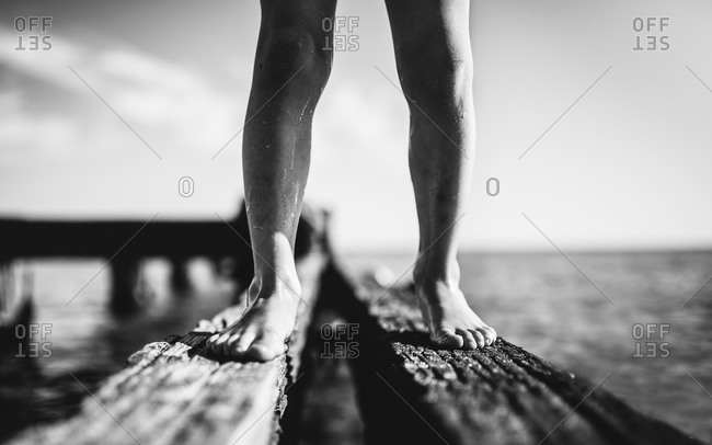 Child's legs standing on beach structure